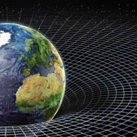 Защо гравитацията ни дърпа надолу, а не ни бута нагоре